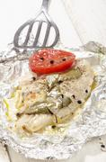 baked pangasius in tin foil - stock photo