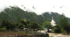 4k tibet people walking around buddhist white stupa in village. Stock Footage