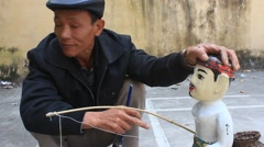 Artisans and water puppetry  Stock Footage