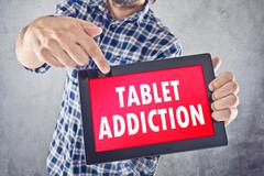 Tablet addiction Stock Illustration