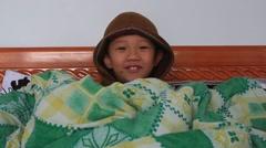 Boy in blanket Stock Footage