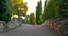 Empty alley in the park during sunset time, 4K Stock Footage