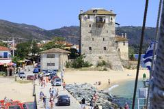 Old tower at the beach in Ouranoupoli - stock photo