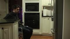 Handicap guy looking fridge Stock Footage