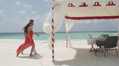 Asian Man And His Fiancee Arrive To Romantic Lunch On Maldivian Sandbank - stock footage