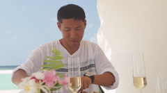 Charming Asian Man Converses Over Luxurious Lunch At Maldivian Seaside Stock Footage