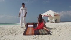 Charming Asian Man Joins His Fiancee On Sun-loungers At Maldivian Seaside Stock Footage