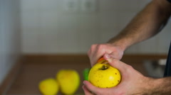 Removing peel from yellow apple Stock Footage
