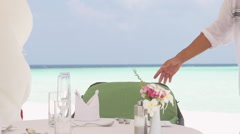 Beautiful Brunette Is Escorted To Romantic Lunch At Maldivian Sandbank Stock Footage