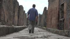 Naples Italy Pompeii man walking along ancient road 4K 028 Stock Footage