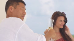Multicultural Couple In Love Poses For Picture With Champagne On The Beach Stock Footage