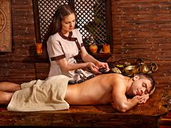 Man having Ayurvedic spa treatment. Stock Photos