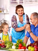 Family with child cooking at kitchen. - stock photo