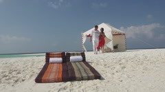 Asian Man Escorts His Beautiful Fiancee To Sunlounger To Relax At Maldivian Sea - stock footage