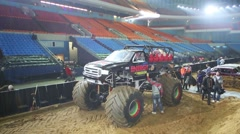 Giant offroader on the sandy arena of sports complex Olympiysky Stock Footage