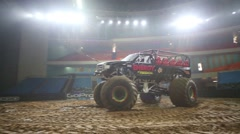 The giant passenger offroader in the arena of the sports complex Stock Footage