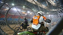 Two Bikers corrected clothes and are preparing to perform a stunt Stock Footage