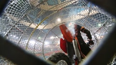 Biker shut off the motorcycle engine inside a metal mesh ball Stock Footage