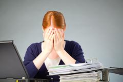 Businesswoman experiencing stress at work Stock Photos