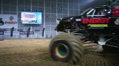Giant passenger offroader makes a turn on the sports show Stock Footage