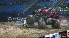 Huge passenger offroader moved wrecked car in the arena Stock Footage