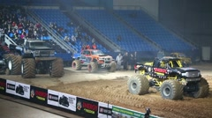 Three Monster Trucks in the arena of sports complex Olimpiyskiy - stock footage