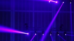Violet rays of spotlights on the ceiling move in a circle Stock Footage