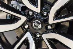 Nissan Sign On Wheel And Break Pad Stock Photos