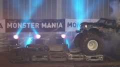 Monster Truck with six wheels crumples cars on sports show Stock Footage