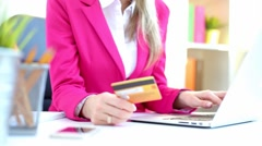 Woman entering credit card data Stock Footage