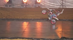 Biker riding on the back wheel on sports entertainment show Stock Footage