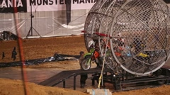 Bikers leave the mesh ball and one rider remains inside Stock Footage