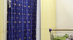 Woman Fitting Room And Blue Pullover Stock Footage