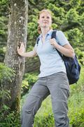 hiking adventure - woman with backpack - stock photo