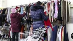 Woman Choosing Pullovers Stock Footage