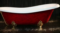 Bathtub with gilded legs standing in studio under dripping water Stock Footage