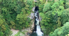 Waterfall in forest aerial view, Skocjan caves - stock footage