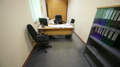A small office with spacious work desk and soft armchairs Stock Footage