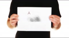 Man holding white message board with text angry and big animated thundercloud Stock Footage