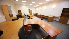 Spacious light office with lots of work desks and cabinets Stock Footage