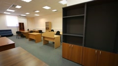 The interior of office space with wooden tables and cabinets Stock Footage