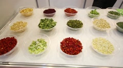 Samples of food at International Exhibition of Food Ingredients Stock Footage
