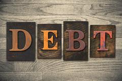debt concept wooden letterpress type - stock photo