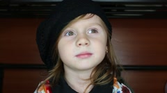 Close-up of a little girl in a hat trying to remove it Stock Footage