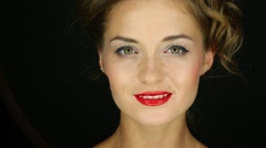 Closeup of the head of a beautiful smiling girl with red lipstick Stock Footage