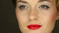 Face of a girl with red lipstick and a circular light in the eyes Stock Footage