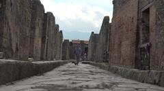 Naples Italy Pompeii man walking forward ancient road 4K 028 Stock Footage