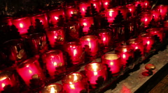 burning candles inside a curch - stock footage