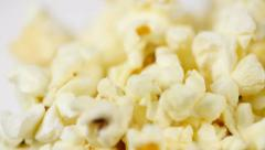 Macro footage of popcorn In Rotation Stock Footage
