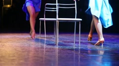 Legs of two female dancers dancing on chairs at stage. Stock Footage